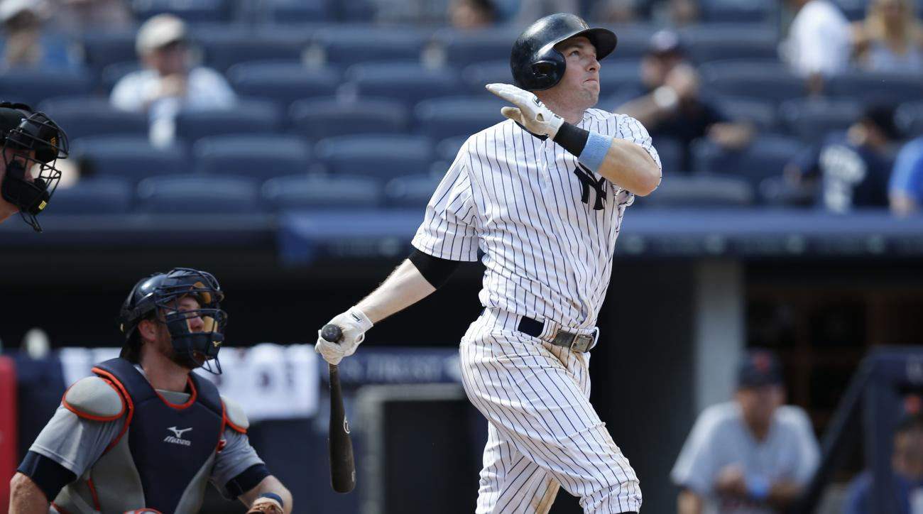 New York Yankees Stephen Drew hits a ninth-inning solo home run off Detroit Tigers relief pitcher Joakim Soria in the Yankees 12-4 loss to the Tigers in a baseball game at Yankee Stadium in New York, Sunday, June 21, 2015. It was Drew's second home run of