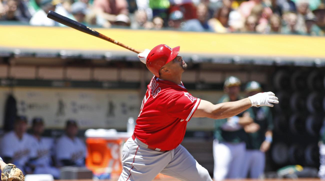 Los Angeles Angels' Albert Pujols looks up as he hits a foul ball against the Oakland Athletics during the first inning of a baseball game, Sunday, June 21, 2015, in Oakland, Calif.  (AP Photo/George Nikitin)