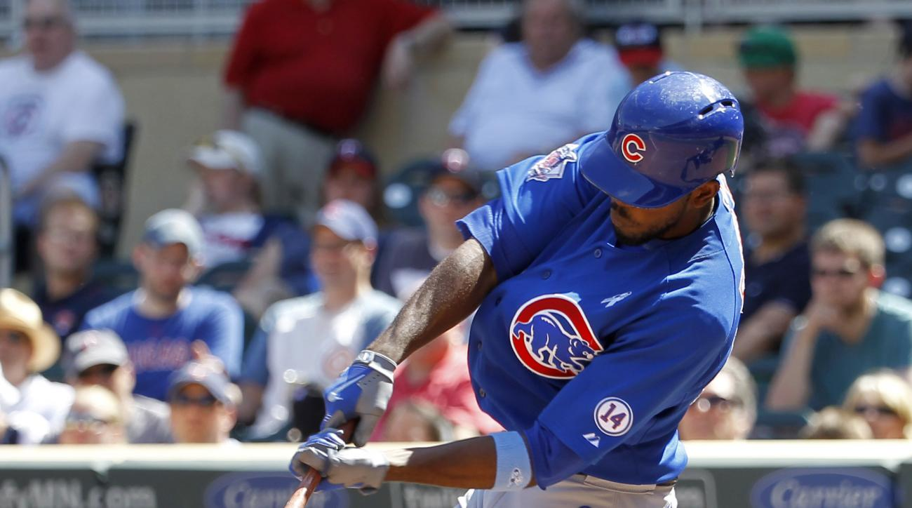 Chicago Cubs'  Dexter Fowler hits a grand slam off Minnesota Twins relief pitcher Aaron Thompson during the eighth inning of a baseball game in Minneapolis, Sunday, June 21, 2015. The Cubs won 8-0. (AP Photo/Ann Heisenfelt)