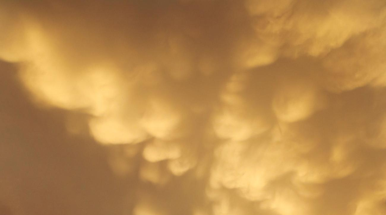 Mammatus clouds form over Wrigley Field during the fifth inning of a baseball game between the Chicago Cubs and the Los Angeles Dodgers Monday, June 22, 2015, in Chicago. (AP Photo/Charles Rex Arbogast)