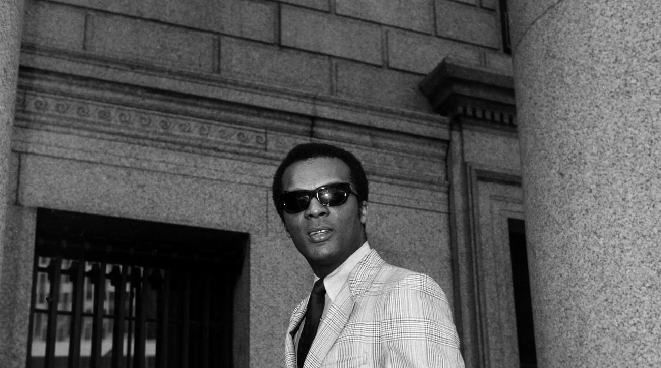 Curt Flood pauses in front of Federal Court in New York City, June 1, 1970 as his legal challenge of baseball's reserve clause resumed. Flood balked being traded by the Cardinals to the Phillies and sued organized baseball for $3 million in damages. (AP P