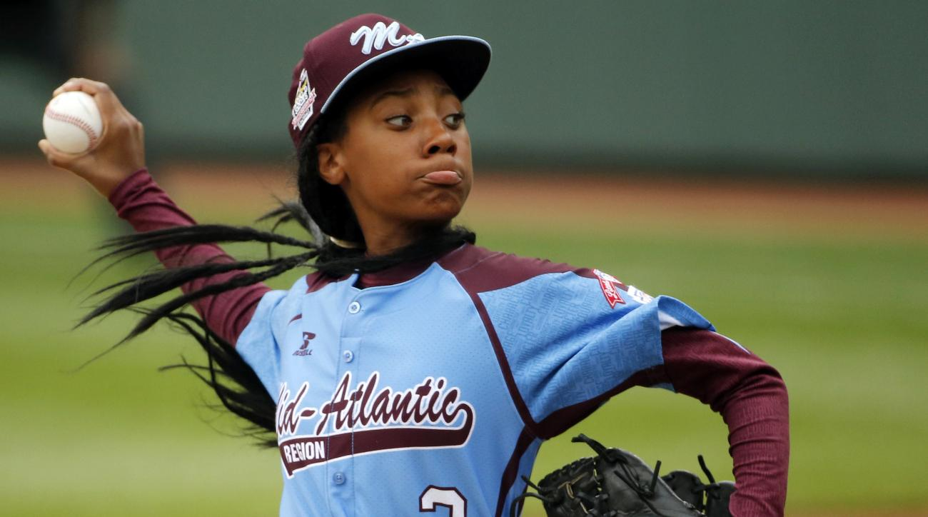 FILE - In this Aug. 15, 2014, file photo, Pennsylvania's Mo'ne Davis throws a pitch in the fifth inning against Tennessee during a baseball game in United States pool play at the Little League World Series tournament in South Williamsport, Pa. Former Atla