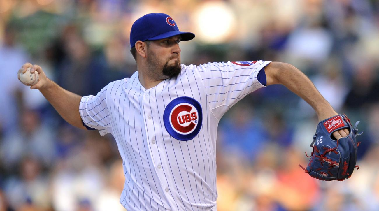 Chicago Cubs starter Jason Hammel delivers a pitch during the first inning of a baseball game against the Los Angeles Dodgers on Tuesday, June 23, 2015, in Chicago. (AP Photo/Paul Beaty)