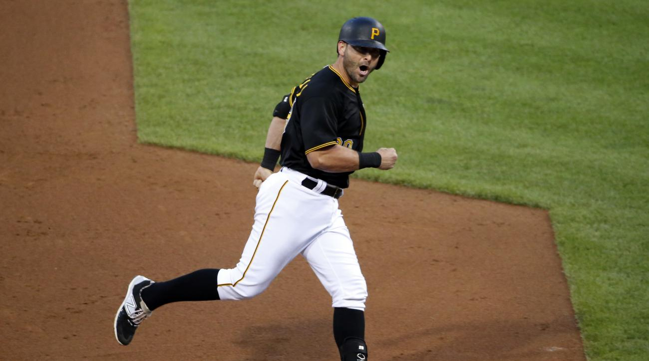 Pittsburgh Pirates' Francisco Cervelli rounds third after hitting a  three-run home run off Cincinnati Reds relief pitcher Pedro Villarreal during the fourth inning of a baseball game in Pittsburgh, Tuesday, June 23, 2015. (AP Photo/Gene J. Puskar)