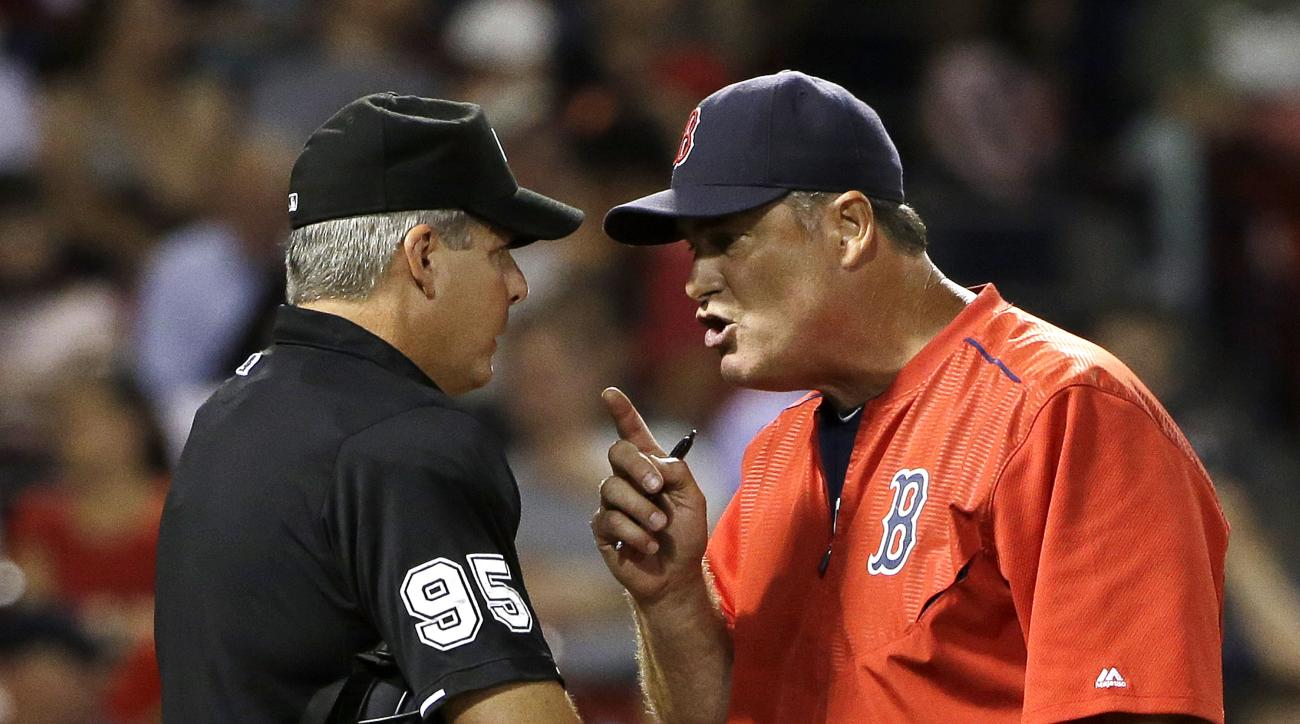 Boston Red Sox manager John Farrell, right, argues with umpire Tim Timmons, left, following the bottom of the sixth inning of a baseball game at Fenway Park, Tuesday, June 23, 2015, in Boston. Farrell was ejected from the game. The Orioles won 6-4. (AP Ph