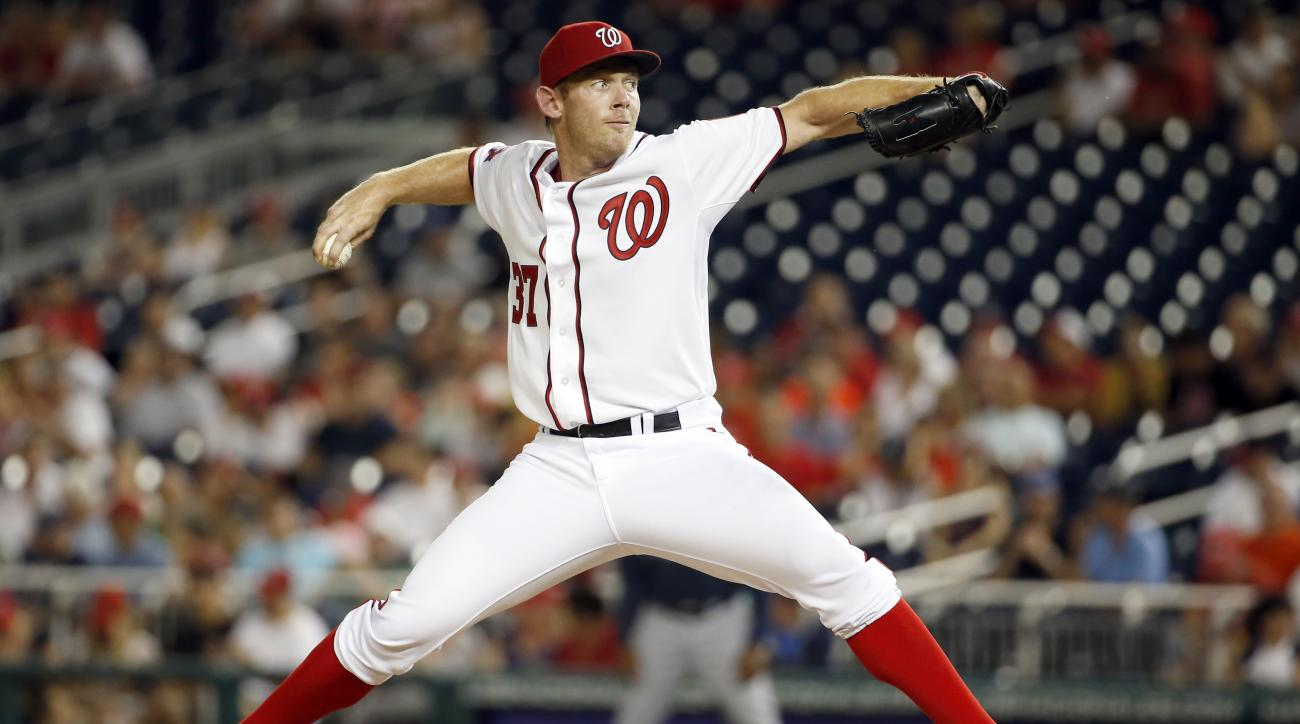 Washington Nationals starting pitcher Stephen Strasburg (37) throws during the  third inning of a baseball game against the Atlanta Braves at Nationals Park, Tuesday, June 23, 2015, in Washington. (AP Photo/Alex Brandon)