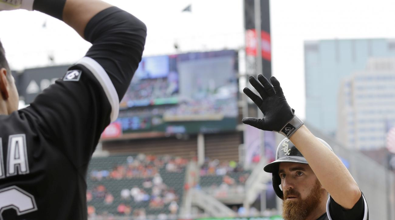 Chicago White Sox designated hitter Adam LaRoche, right, celebrates his solo home run off Minnesota Twins starting pitcher Phil Hughes during the second inning of a baseball game in Minneapolis, Wednesday, June 24, 2015. (AP Photo/Ann Heisenfelt)