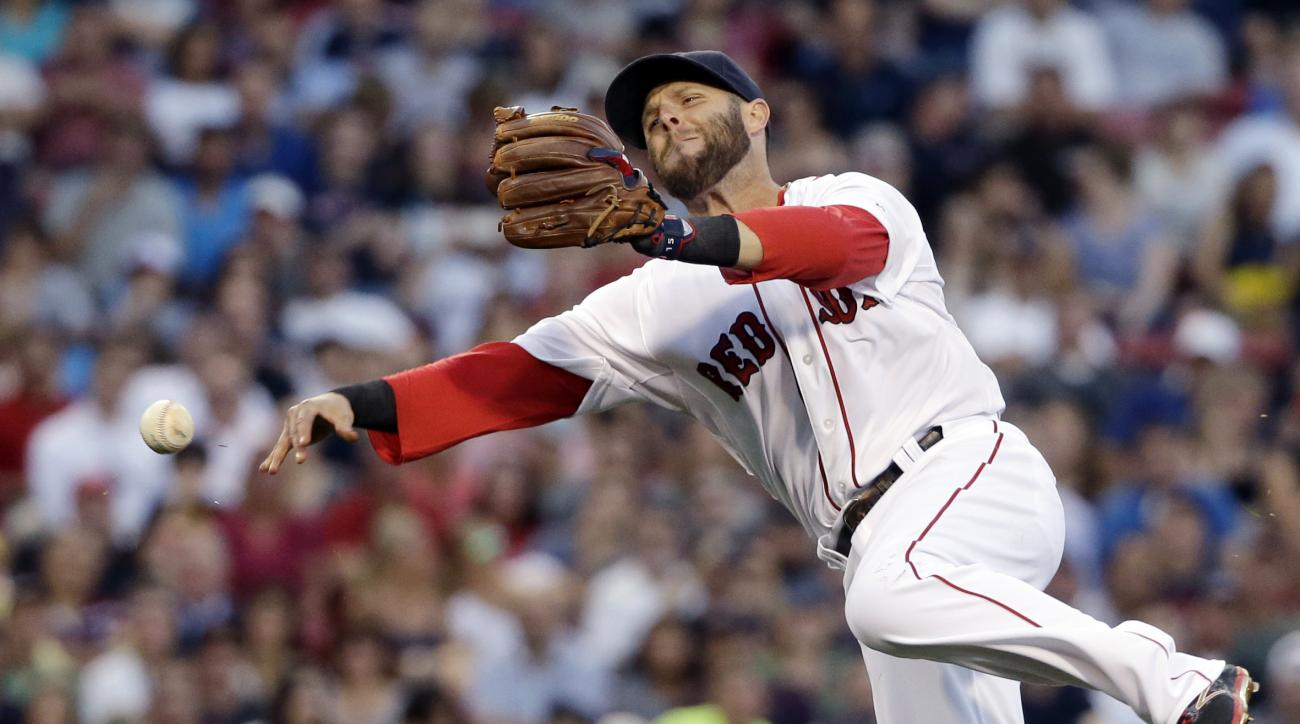 Boston Red Sox second baseman Dustin Pedroia throws to first but can't get Baltimore Orioles' Travis Snider on an infield single in the fourth inning of a baseball game at Fenway Park, Wednesday, June 24, 2015, in Boston. (AP Photo/Elise Amendola)