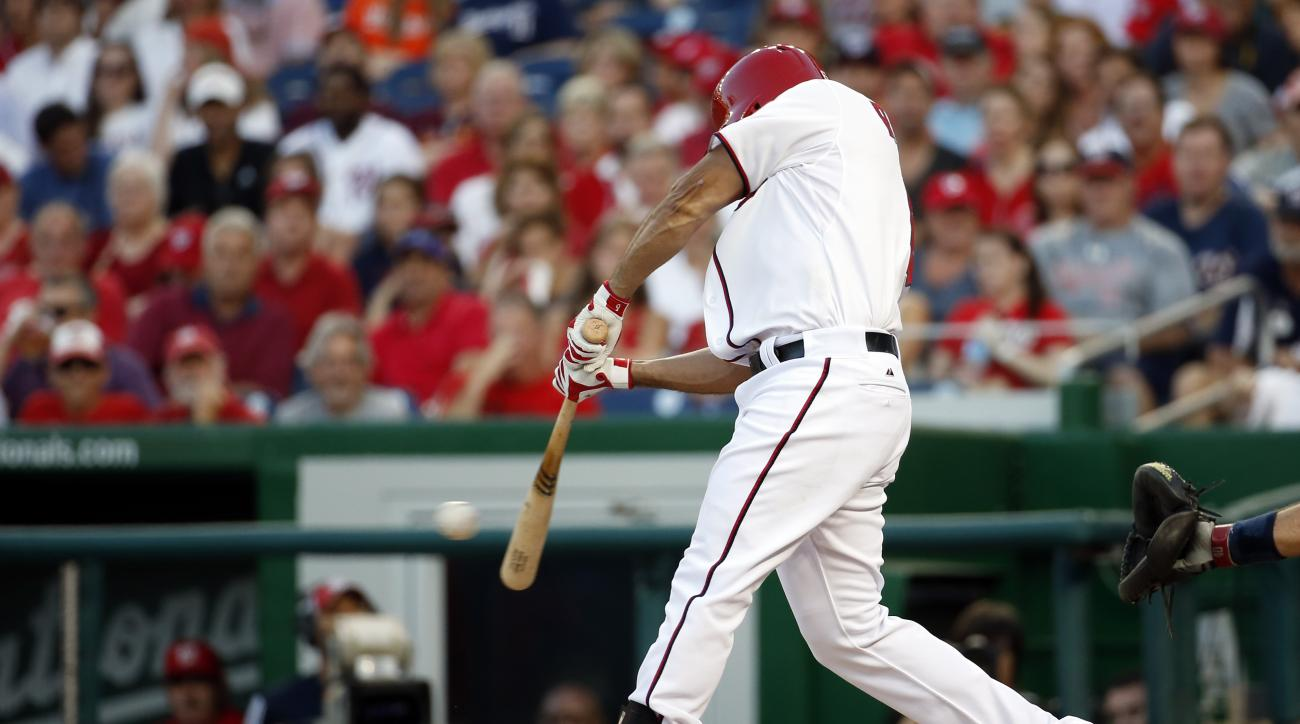 Washington Nationals' Anthony Rendon hits a single during the  fourth inning of a baseball game against the Atlanta Braves at Nationals Park, Wednesday, June 24, 2015, in Washington. (AP Photo/Alex Brandon)