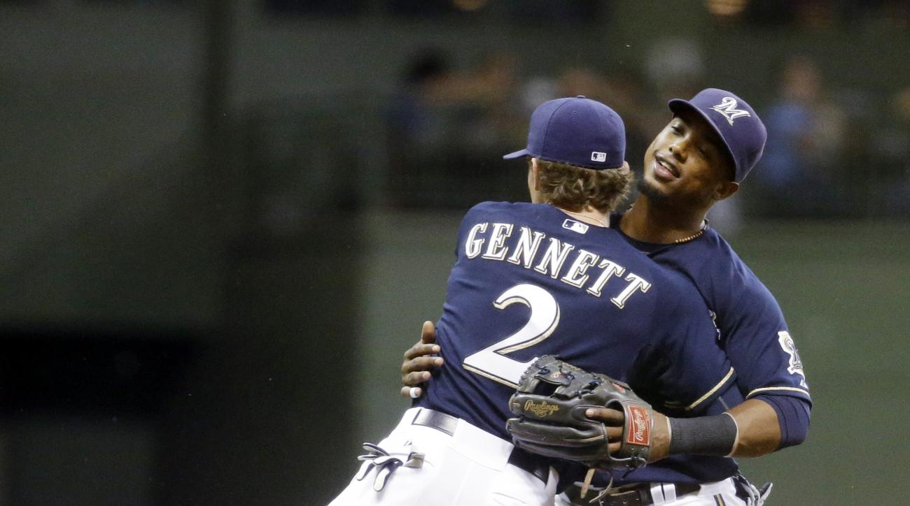 Milwaukee Brewers' Scooter Gennett and Jean Segura celebrate after a baseball game against the New York Mets Wednesday, June 24, 2015, in Milwaukee. The Brewers won 4-1. (AP Photo/Morry Gash)