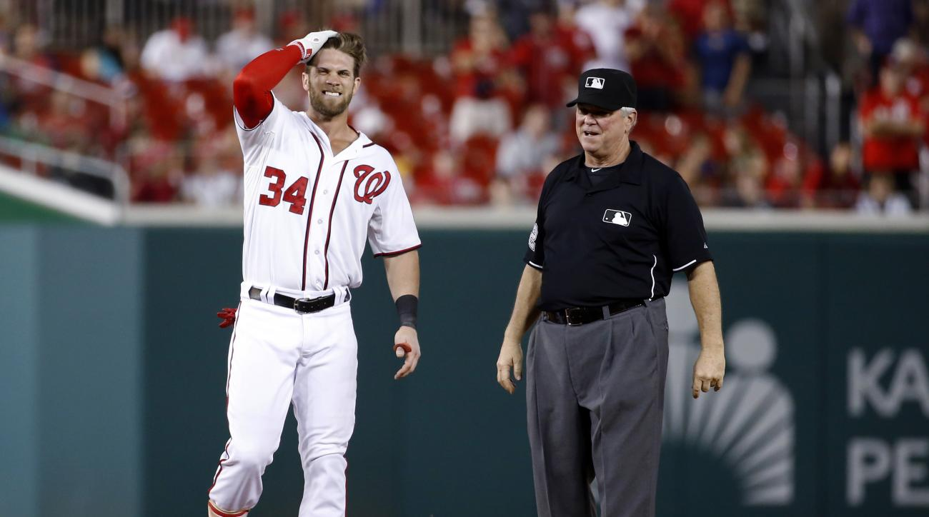 Washington Nationals' Bryce Harper grimaces after running to second base for a double during the 11th inning of a baseball game against the Atlanta Braves at Nationals Park, Wednesday, June 24, 2015, in Washington. Nationals manager Matt Williams and trai