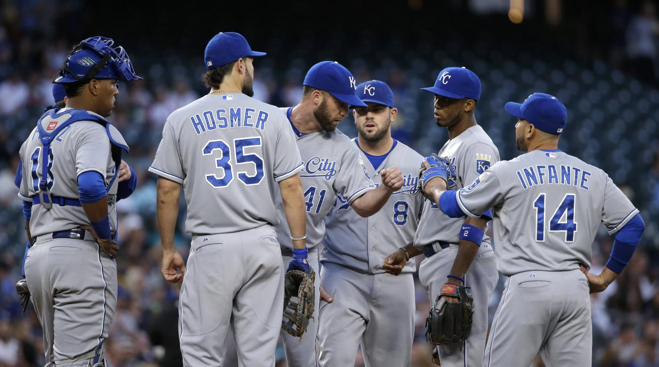 Kansas City Royals starting pitcher Danny Duffy (41) meets with infielders on the mound as he is taken out against the Seattle Mariners in the fifth inning of a baseball game Wednesday, June 24, 2015, in Seattle. (AP Photo/Elaine Thompson)