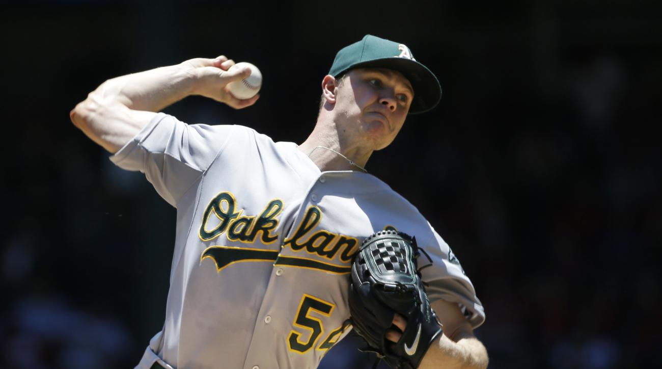 Oakland Athletics starting pitcher Sonny Gray throws during the first inning of a baseball game against the Texas Rangers in Arlington, Texas, Thursday, June 25, 2015. (AP Photo/LM Otero)