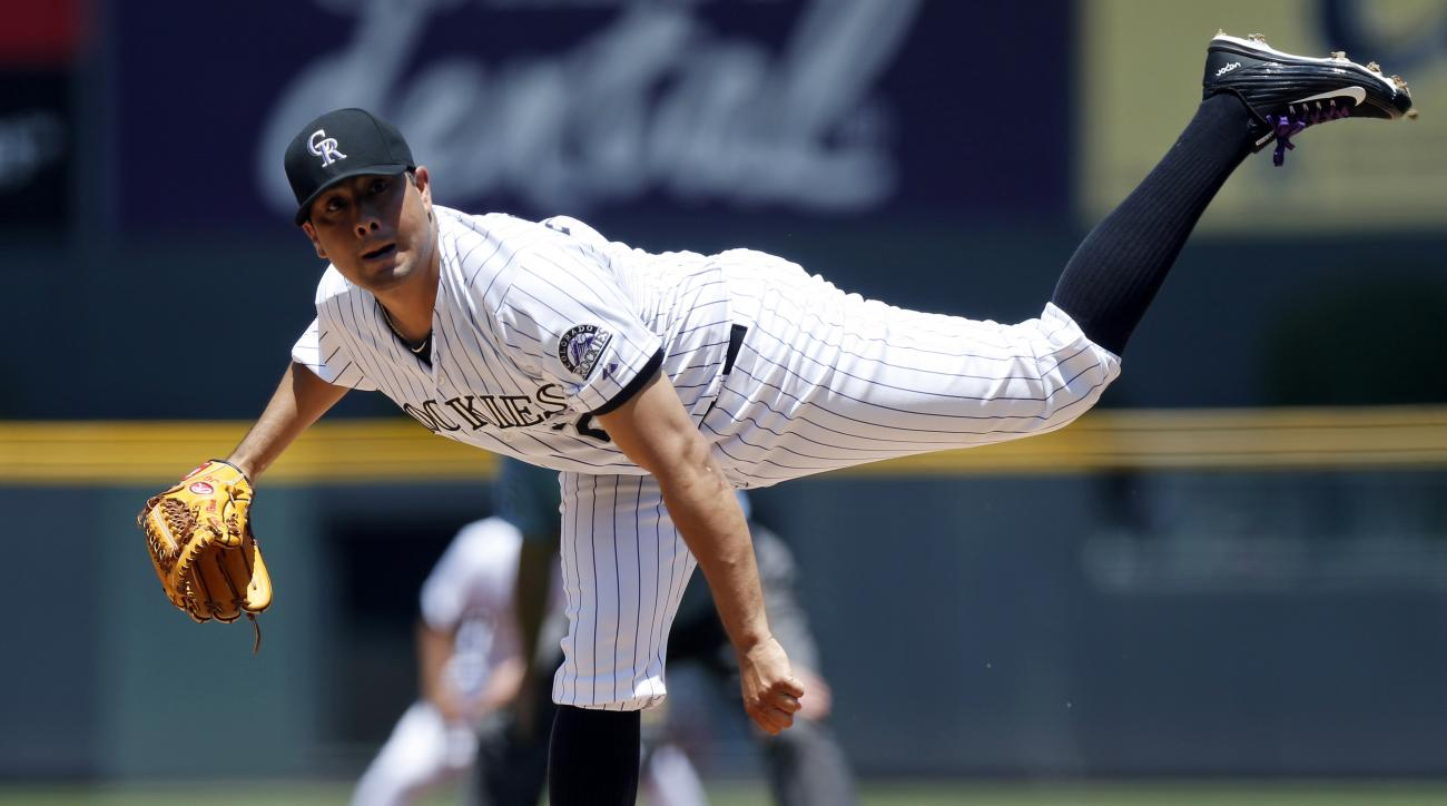 Colorado Rockies starting pitcher Jorge De La Rosa works against the Arizona Diamondbacks in the first inning of a baseball game, Thursday, June 25, 2015, in Denver. (AP Photo/David Zalubowski)