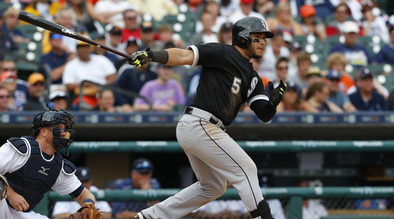 Chicago White Sox's Carlos Sanchez hits a three-run triple against the Detroit Tigers in the 10th inning of a baseball game in Detroit, Thursday, June 25, 2015. (AP Photo/Paul Sancya)