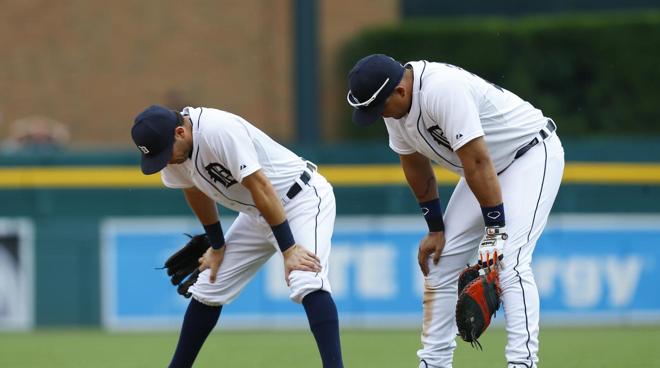 Detroit Tigers second baseman Ian Kinsler, left, and Miguel Cabrera look down at the ground  in the eighth inning of a baseball game against the Chicago White Sox in Detroit, Thursday, June 25, 2015. Detroit lost 8-7 in 10 innings. (AP Photo/Paul Sancya)