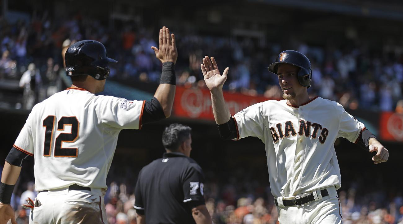 San Francisco Giants' Joe Panik, left, and Matt Duffy celebrate after scoring against the San Diego Padres in the eighth inning of a baseball game Thursday, June 25, 2015, in San Francisco. Both scored on a double by Buster Posey. (AP Photo/Ben Margot)