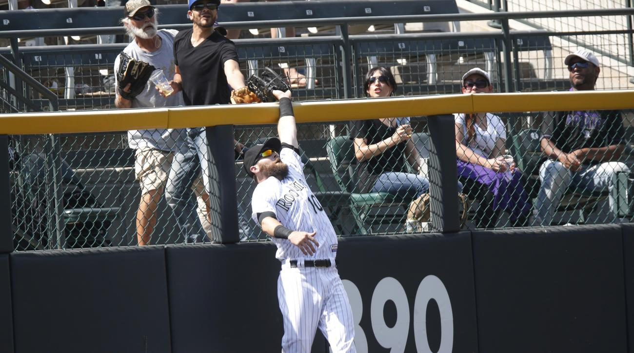 Colorado Rockies left fielder Ben Paulsen pulls in a fly ball hit by Arizona Diamondbacks' Chris Owings during the eighth inning of a baseball game Thursday, June 25, 2015, in Denver. Colorado won 6-4. (AP Photo/David Zalubowski)