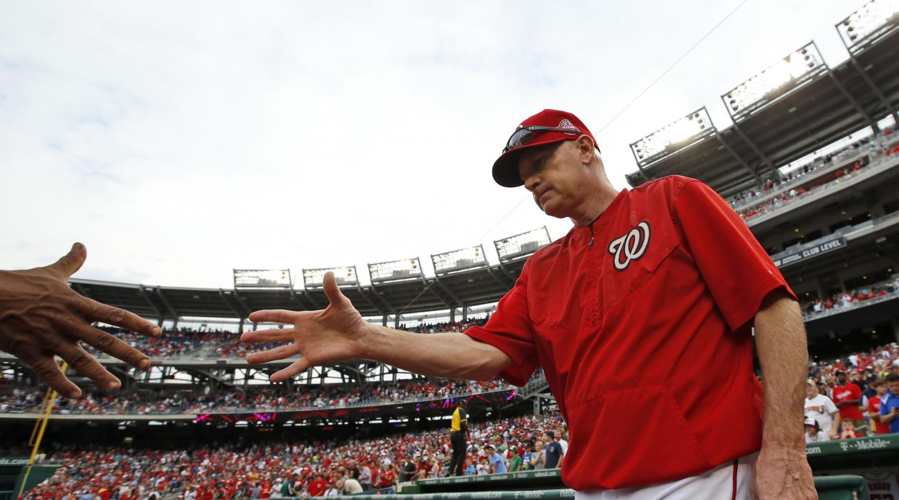 Washington Nationals manager Matt Williams reaches to shake hands to celebrate after a baseball game against the Atlanta Braves at Nationals Park, Thursday, June 25, 2015, in Washington. The Nationals won 7-0. (AP Photo/Alex Brandon)