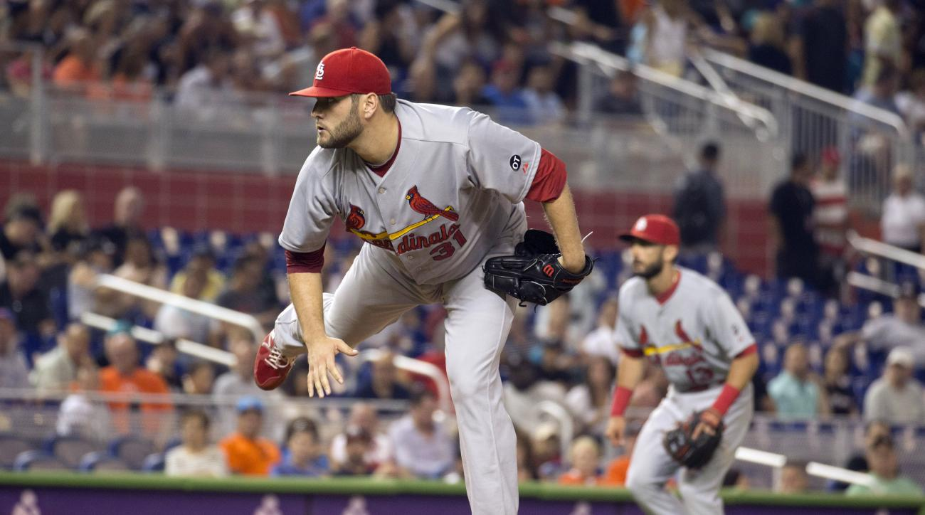 St. Louis Cardinals starting pitcher Lance Lynn (31) throws to the Miami Marlins during the first inning of a baseball game in Miami, Thursday, June 25, 2015. (AP Photo/J Pat Carter)
