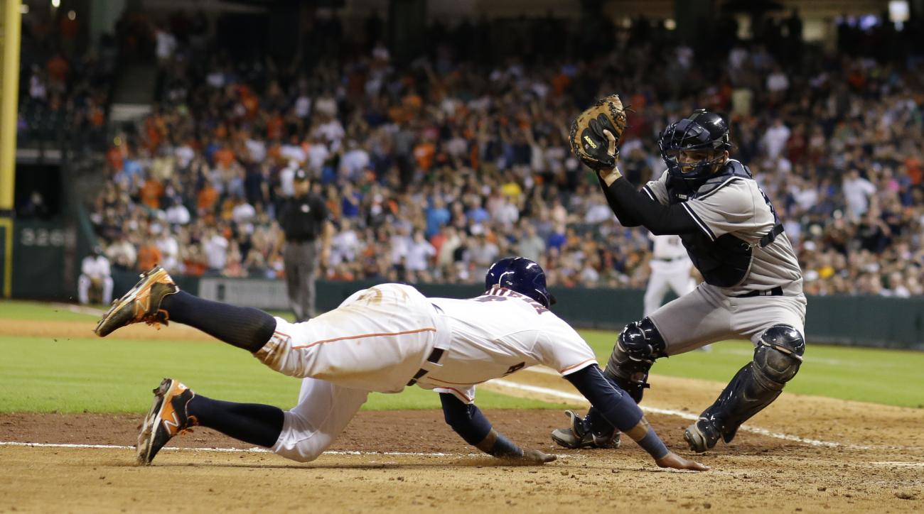 New York Yankees catcher John Ryan Murphy, right, prepares to tag out Houston Astros' Luis Valbuena, left, as he tried to score during the eighth inning of a baseball game Thursday, June 25, 2015, in Houston. (AP Photo/David J. Phillip)