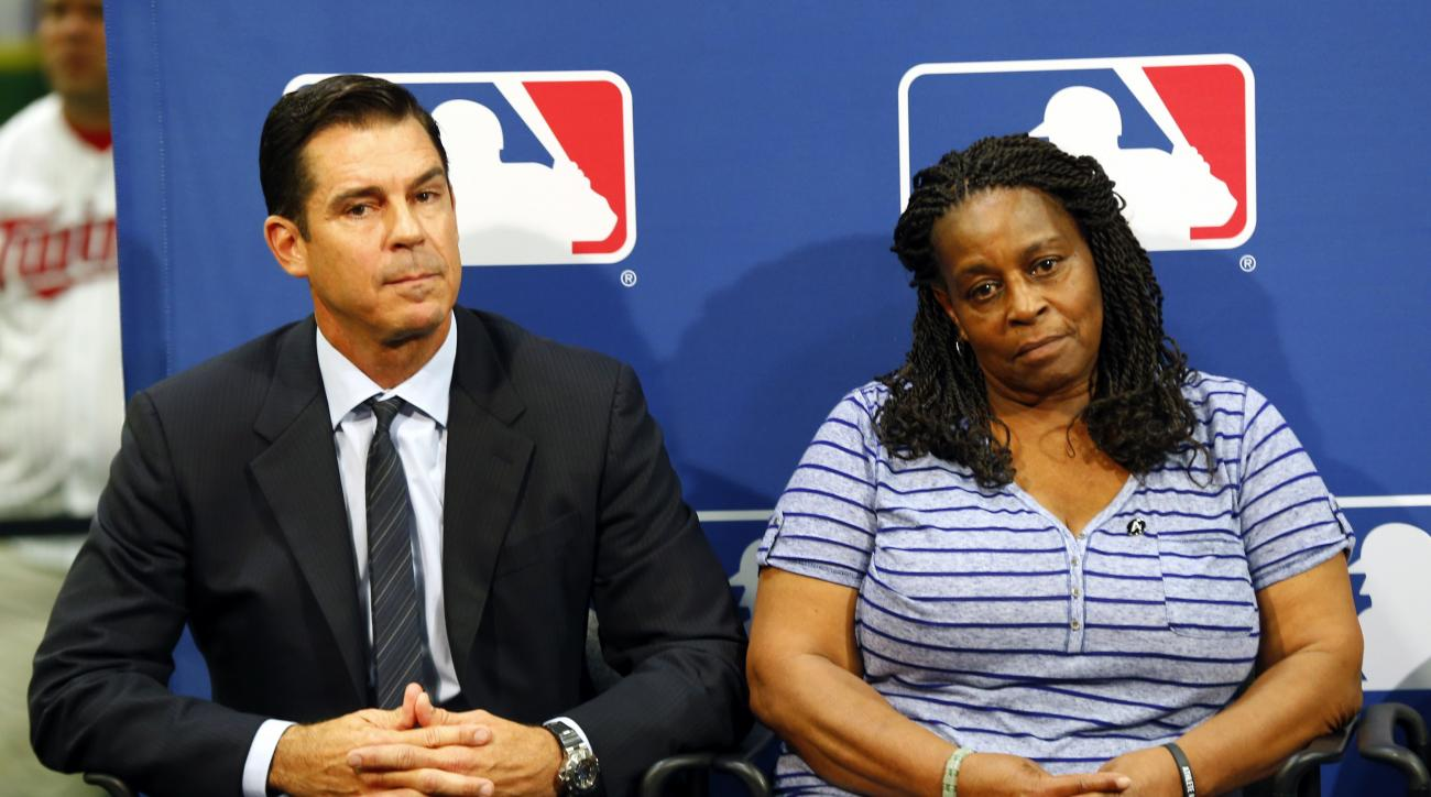 FILE - In this July 15, 2014, file photo, former major league outfielder Billy Bean, left, and Lutha Burke look on during a news conference at baseball's All-Star game in Minneapolis. Major League Baseball had appointed Bean, who came out as gay after his