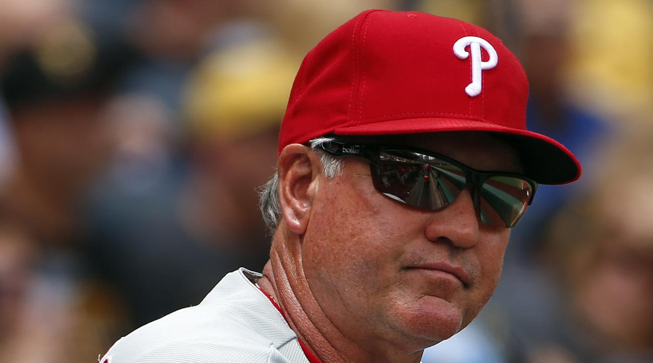 FILE - In this June 14, 2015, file photo, Philadelphia Phillies manager Ryne Sandberg stands in the dugout during a baseball game against the Pittsburgh Pirates in Pittsburgh. Sandberg resigned as manager of the baseball club on Friday, June 26, 2015. (AP