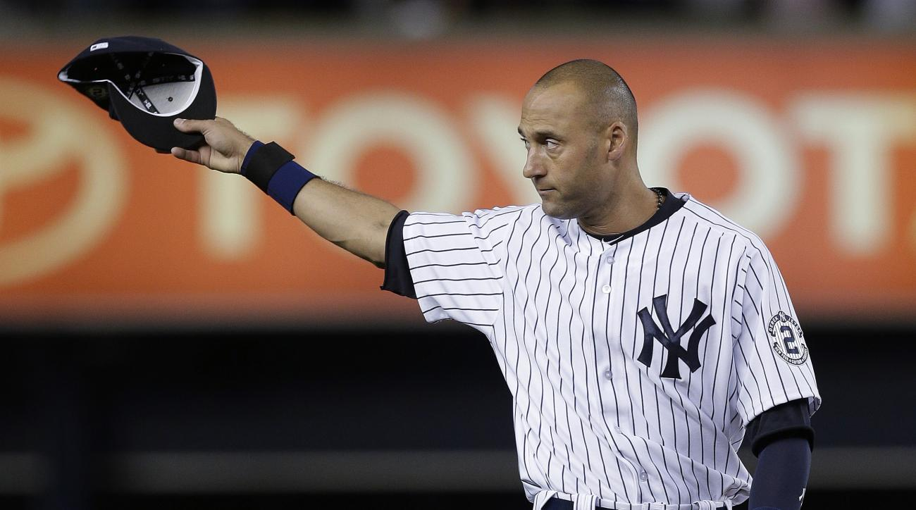 FILE - In this Sept. 25, 2014, file photo, New York Yankees shortstop Derek Jeter acknowledges applause from fans as he takes the field for a baseball game against the Baltimore Orioles in New York. Jeter, who lived in New Jersey until he was four-years-o