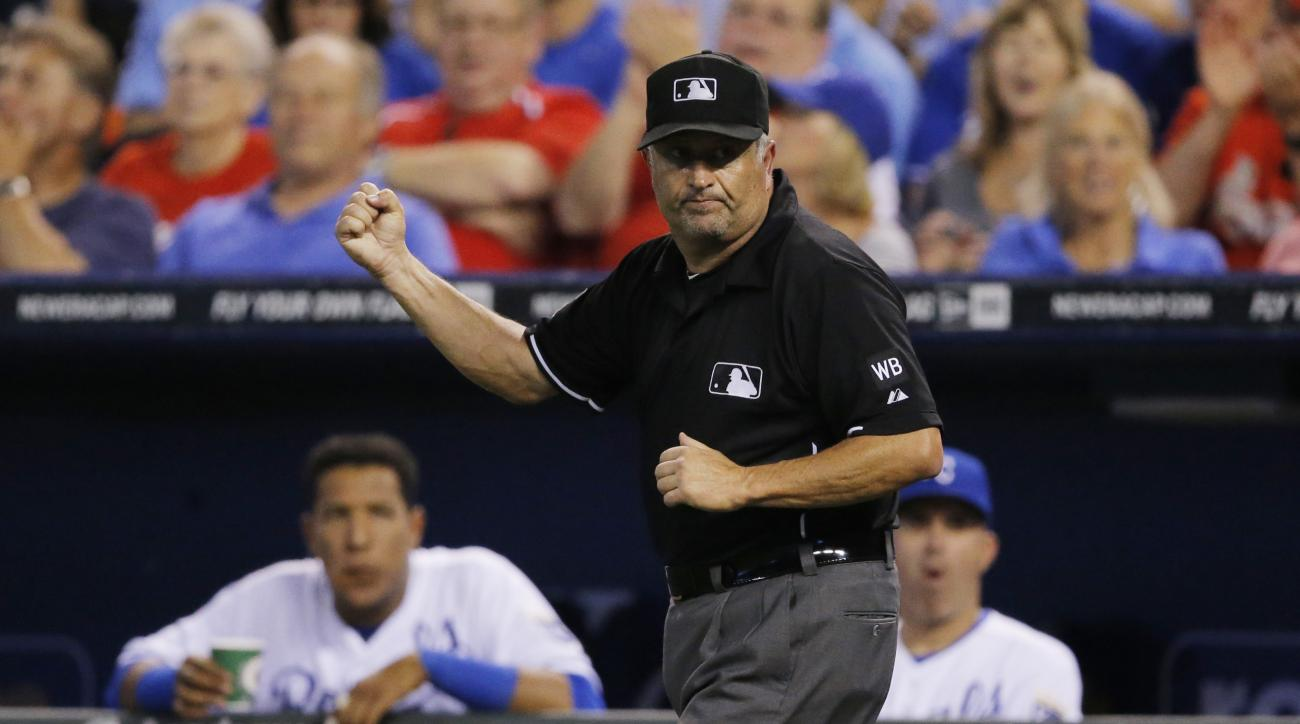 FILE - In this June 4, 2014, file photo, umpire Dale Scott makes a call after review during a baseball game between the St. Louis Cardinals and Kansas City Royals at Kauffman Stadium in Kansas City, Mo. Dale Scott, who came out as gay last winter, called