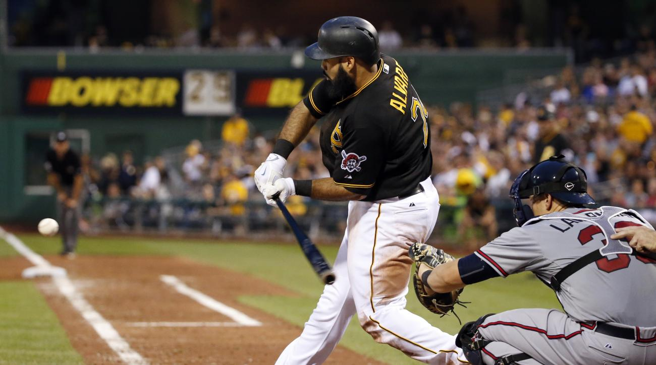 Pittsburgh Pirates' Pedro Alvarez drives in two runs with a double off Atlanta Braves relief pitcher Luis Avilan during the fifth inning of a baseball game in Pittsburgh, Friday, June 26, 2015. (AP Photo/Gene J. Puskar)