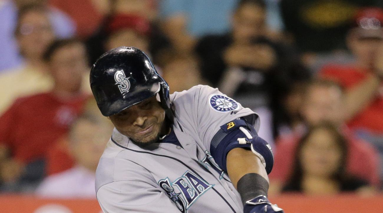 Seattle Mariners' Nelson Cruz hits an RBI double during the sixth inning of a baseball game against the Los Angeles Angels, Friday, June 26, 2015, in Anaheim, Calif. (AP Photo/Jae C. Hong)
