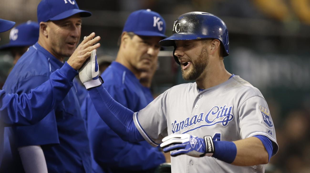 Kansas City Royals' Alex Gordon, right, is congratulated after hitting a home run off Oakland Athletics' Jesse Hahn during the sixth inning of a baseball game Friday, June 26, 2015, in Oakland, Calif. (AP Photo/Ben Margot)