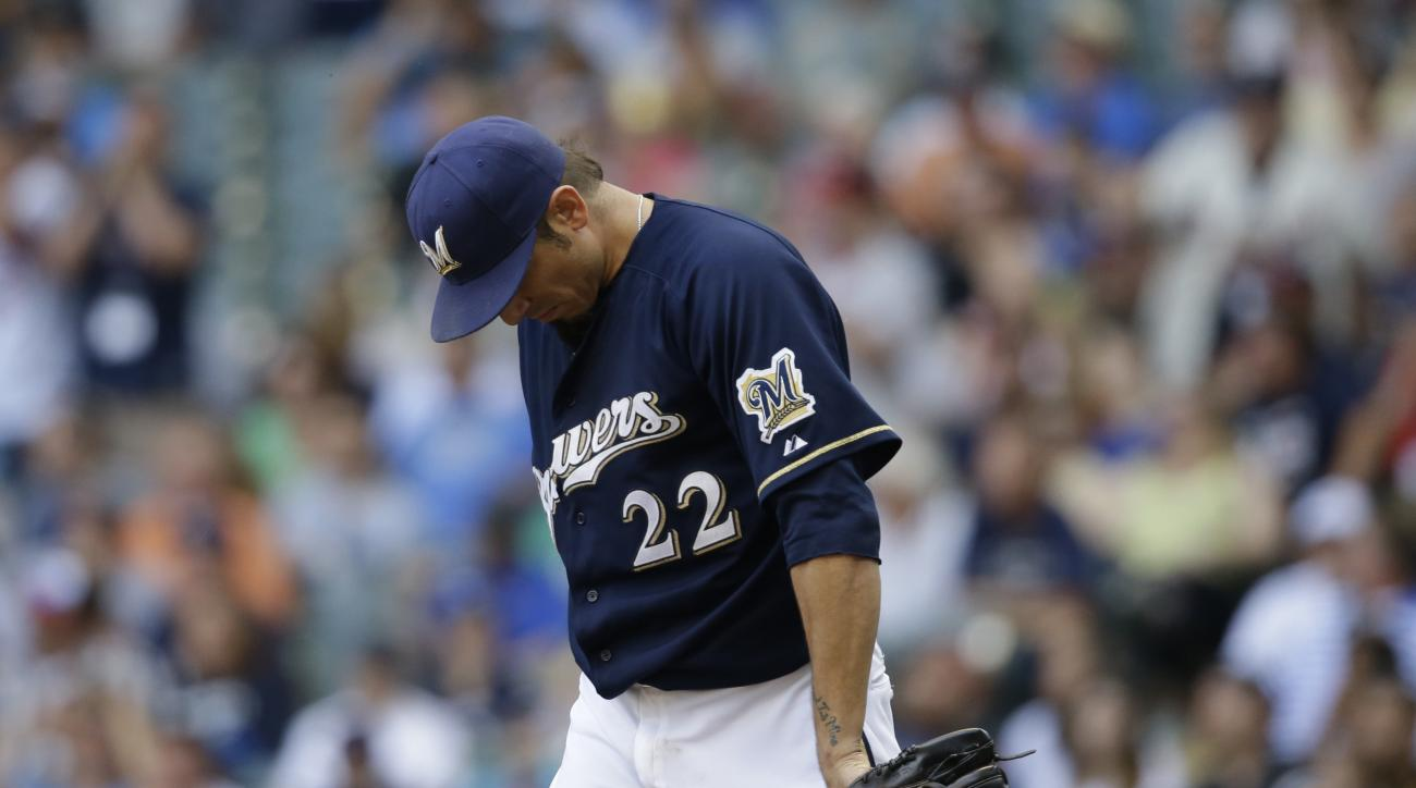 Milwaukee Brewers starting pitcher Matt Garza hangs his head after giving up a home run to the Minnesota Twins' Torii Hunter during the sixth inning of a baseball game against the Milwaukee Brewers Saturday, June 27, 2015, in Milwaukee. (AP Photo/Jeffrey