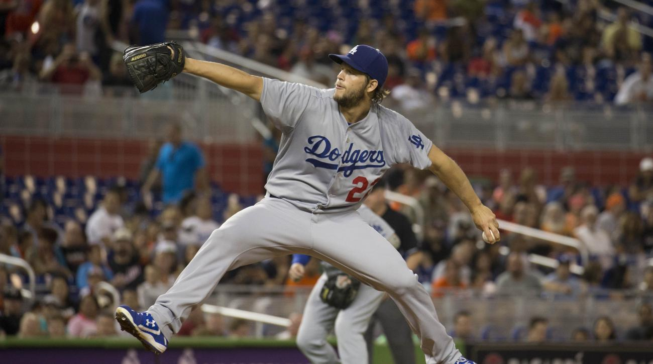 Los Angeles Dodgers starting pitcher Clayton Kershaw (22) throws to the Miami Marlins during the first inning of a baseball game in Miami, Saturday, June 27, 2015. (AP Photo/J Pat Carter)