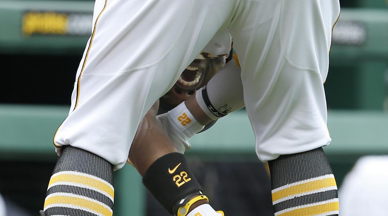 Pittsburgh Pirates' Andrew McCutchen holds his arm after being hit by a pitch by Atlanta Braves starting pitcher Julio Teheran in the first inning of a baseball game, Saturday, June 27, 2015, in Pittsburgh. McCutchen left the game after being hit. (AP Pho