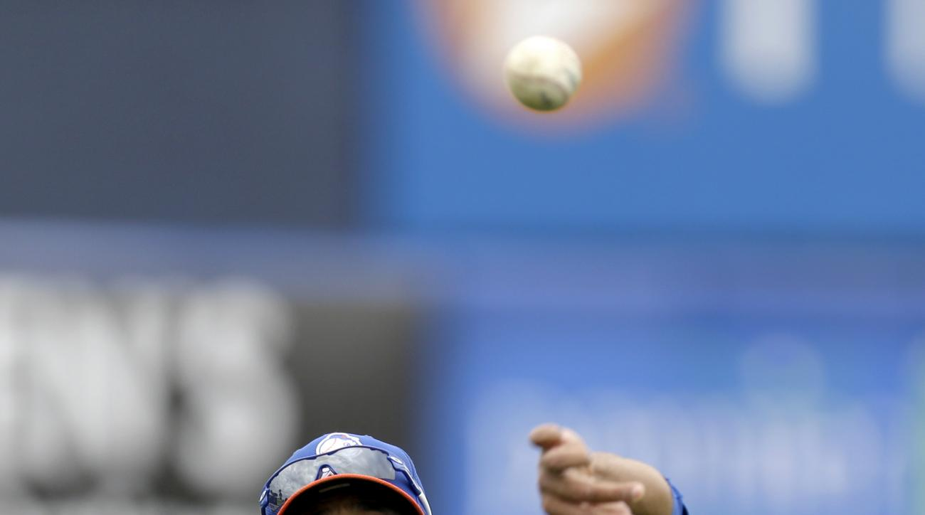 FILE - In this March 1, 2013 file photo, New York Mets pitcher Johan Santana throws while working out before the Mets' spring training baseball game against the Detroit Tigers, in Port St. Lucie, Fla. Santana will take the mound in Venezuela for the Navag