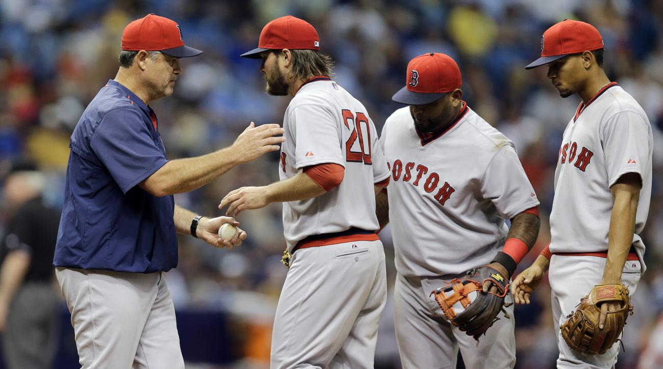 Boston Red Sox starting pitcher Wade Miley, second from left, hands the ball to manager John Farrell, left, after being taken out of a baseball game against the Tampa Bay Rays during the seventh inning Saturday, June 27, 2015, in St. Petersburg, Fla. Red