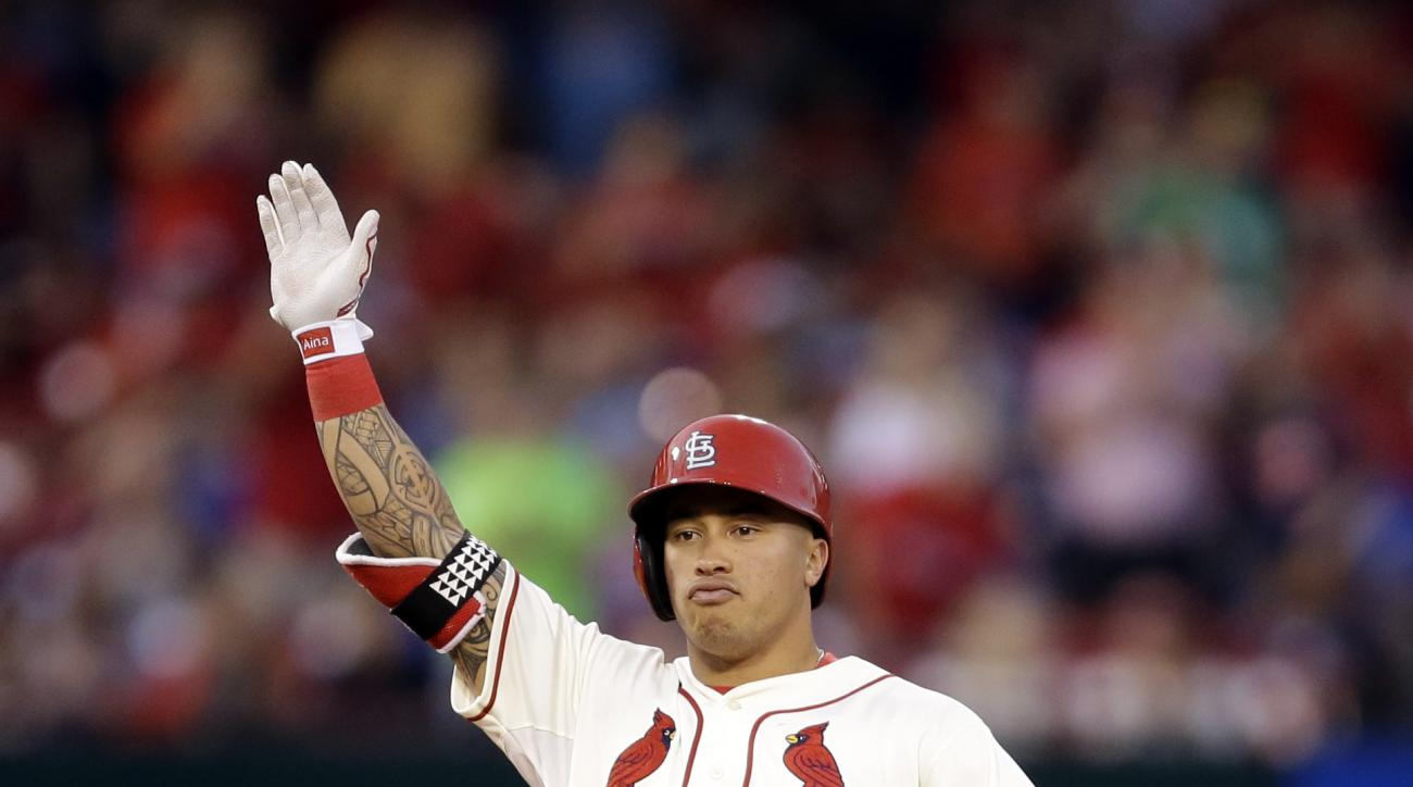 St. Louis Cardinals' Kolten Wong celebrates after hitting a two-run ground-rule double during the fifth inning of a baseball game against the Chicago Cubs Saturday, June 27, 2015, in St. Louis. (AP Photo/Jeff Roberson)