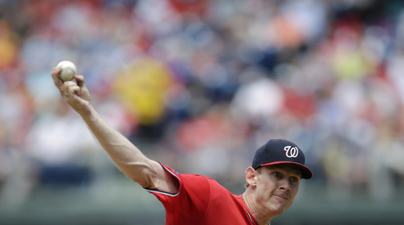 Washington Nationals' Stephen Strasburg pitches during the third inning of the first game of a baseball doubleheader against the Philadelphia Phillies, Sunday, June 28, 2015, in Philadelphia. (AP Photo/Matt Slocum)