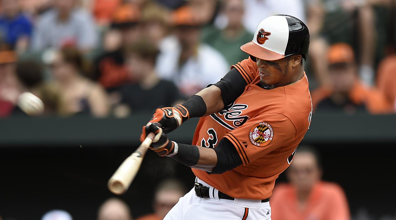 Baltimore Orioles' Jimmy Parades connects for a two-run home run against the Cleveland Indians in the third inning of a baseball game Sunday, June 28, 2015, in Baltimore. (AP Photo/Gail Burton)