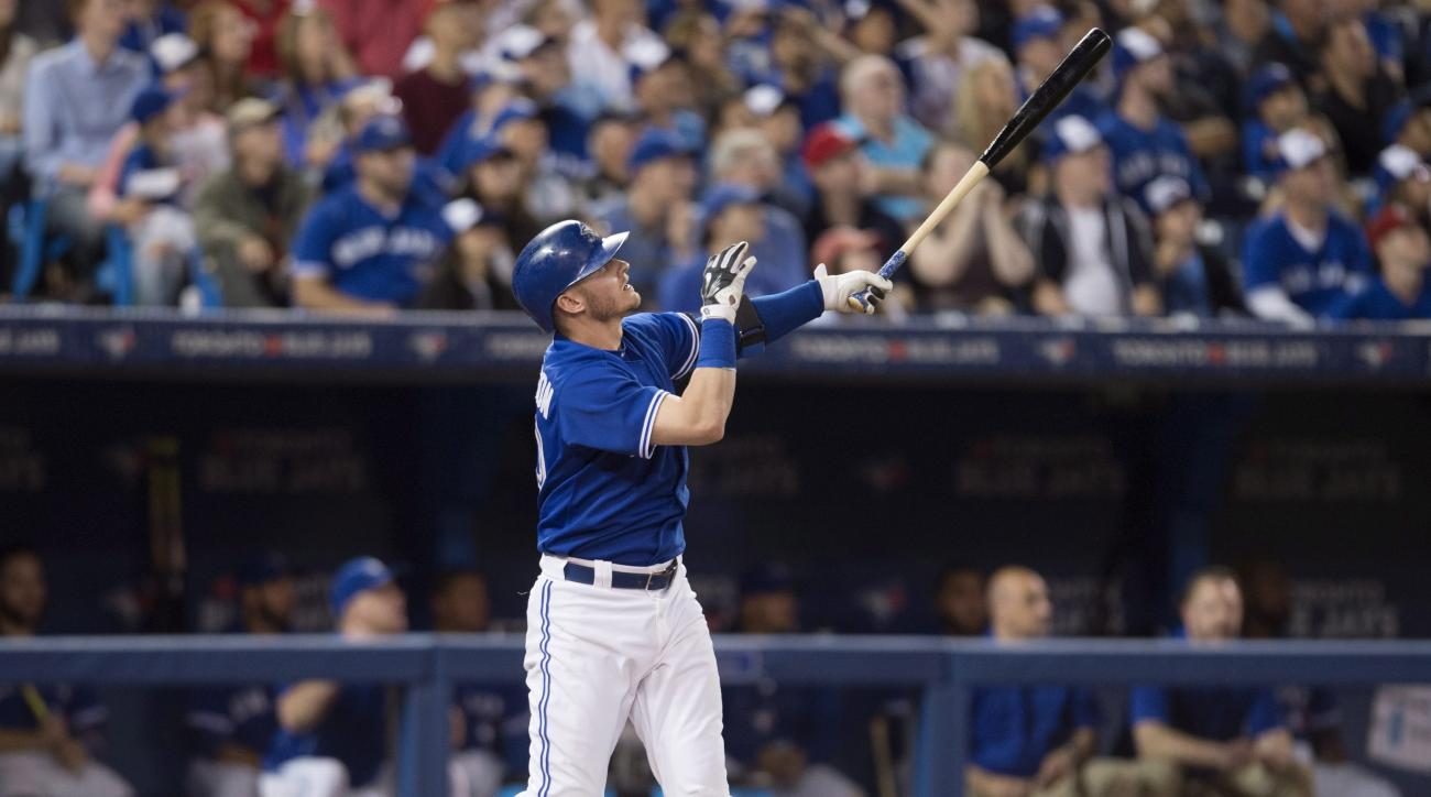 Toronto Blue Jays' Josh Donaldson hits a solo home run during fourth-inning baseball game action against the Texas Rangers in Toronto on Sunday, June 28, 2015. (Darren Calabrese/The Canadian Press via AP) MANDATORY CREDIT