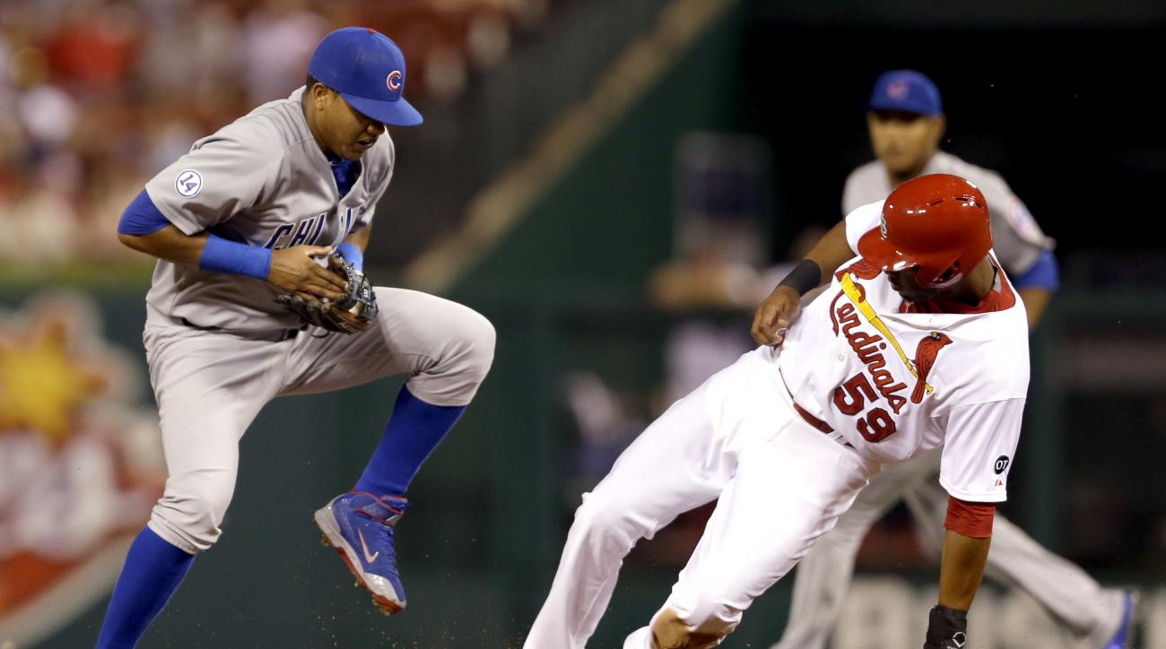 St. Louis Cardinals' Xavier Scruggs, right, is safe at second for a stolen base as Chicago Cubs shortstop Starlin Castro handles the throw during the second inning of a baseball game Sunday, June 28, 2015, in St. Louis. (AP Photo/Jeff Roberson)