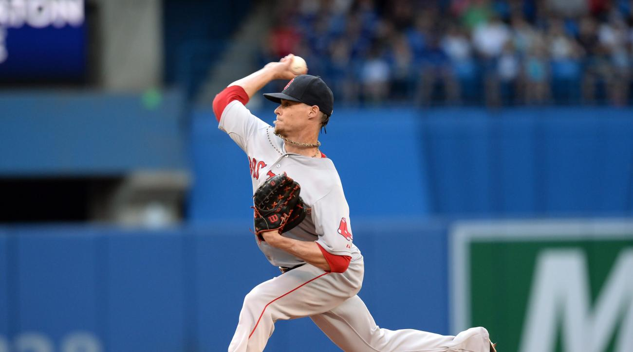 Boston Red Sox pitcher Clay Buchholz works against the Toronto Blue Jays during first inning of a baseball game in Toronto, Monday, June 29, 2015. (Frank Gunn/The Canadian Press via AP) MANDATORY CREDIT