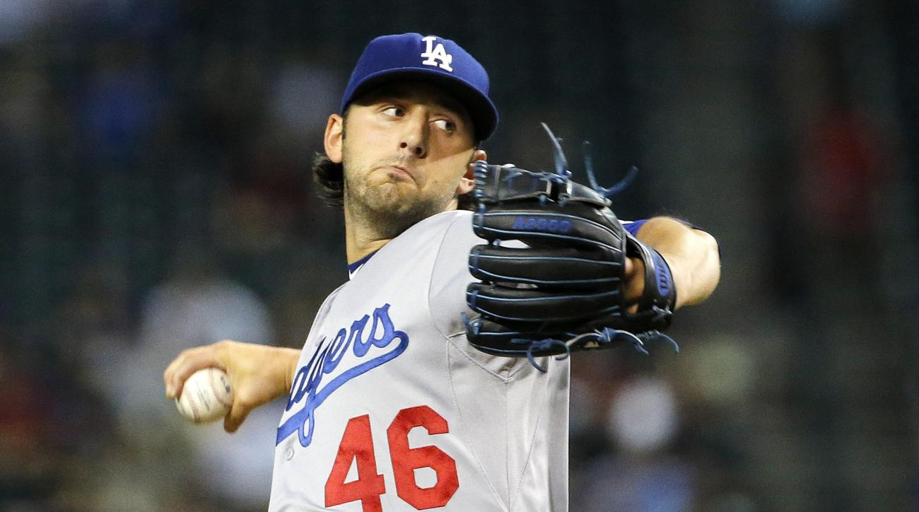 Los Angeles Dodgers' Mike Bolsinger throws a pitch against the Arizona Diamondbacks during the first inning of a baseball game Monday, June 29, 2015, in Phoenix. (AP Photo/Ross D. Franklin)