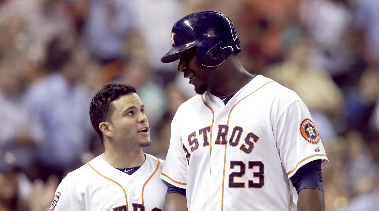 Houston Astros' Jose Altuve (27) congratulates Chris Carter (23) on his solo homer against the Kansas City Royals in the fifth inning of a baseball game Monday, June 29, 2015, in Houston. (AP Photo/Pat Sullivan)
