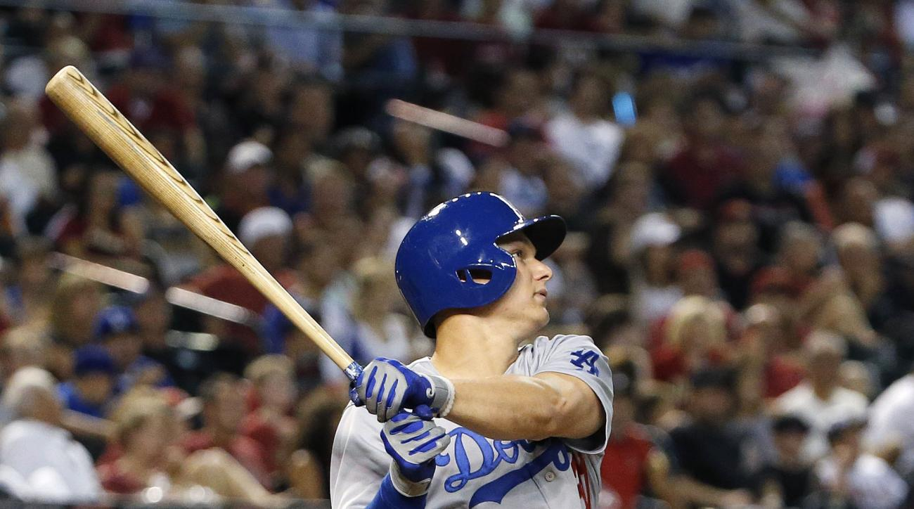 Los Angeles Dodgers' Joc Pederson watches his home run hit against the Arizona Diamondbacks during the fourth inning of a baseball game Monday, June 29, 2015, in Phoenix.  Pederson's home run was the third of the inning for the Dodgers. (AP Photo/Ross D.