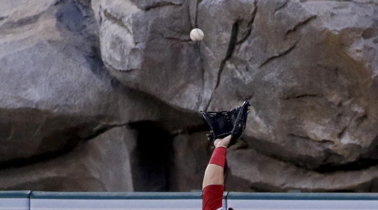 Los Angeles Angels center fielder Mike Trout catches a fly ball hit by New York Yankees' Chris Young during the third inning of a baseball game in Anaheim, Calif., Monday, June 29, 2015. (AP Photo/Chris Carlson)