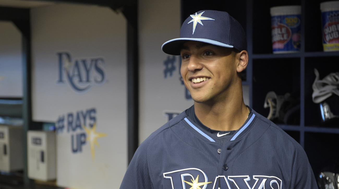 Tampa Bay Rays first-round draft pick Garrett Whitley watches from the dugout during batting practice after signing his contract before a baseball game against the Cleveland Indians in St. Petersburg, Fla., Tuesday, June 30, 2015. (AP Photo/Phelan M. Eben