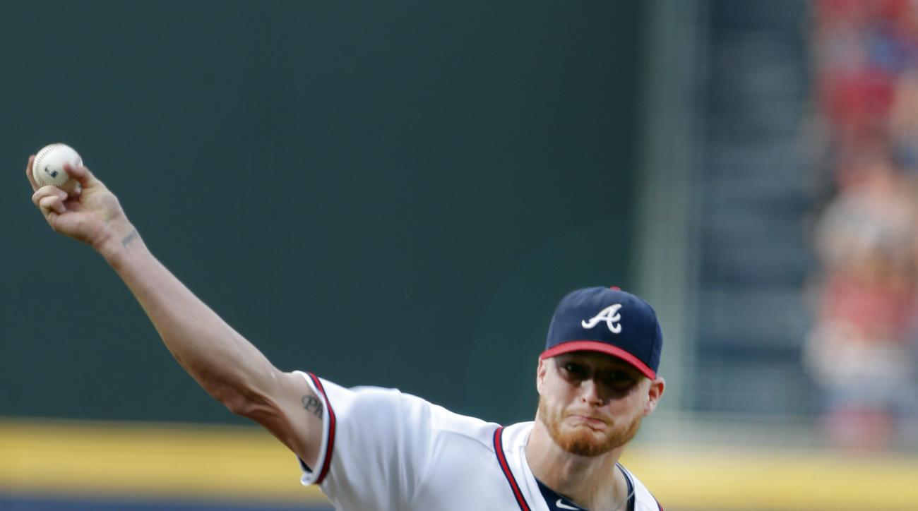 Atlanta Braves starting pitcher Shelby Miller (17) works in the first inning of a baseball game against the Washington Nationals Tuesday, June 30, 2015, in Atlanta.  (AP Photo/John Bazemore)