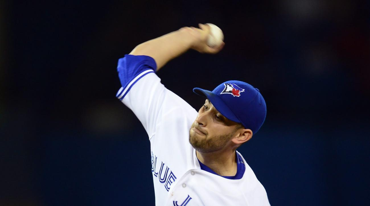 Toronto Blue Jays starting pitcher Marco Estrada works against the Boston Red Sox during first inning American League baseball action in Toronto on Tuesday, June 30, 2015.      (Frank Gunn/The Canadian Press via AP) MANDATORY CREDIT
